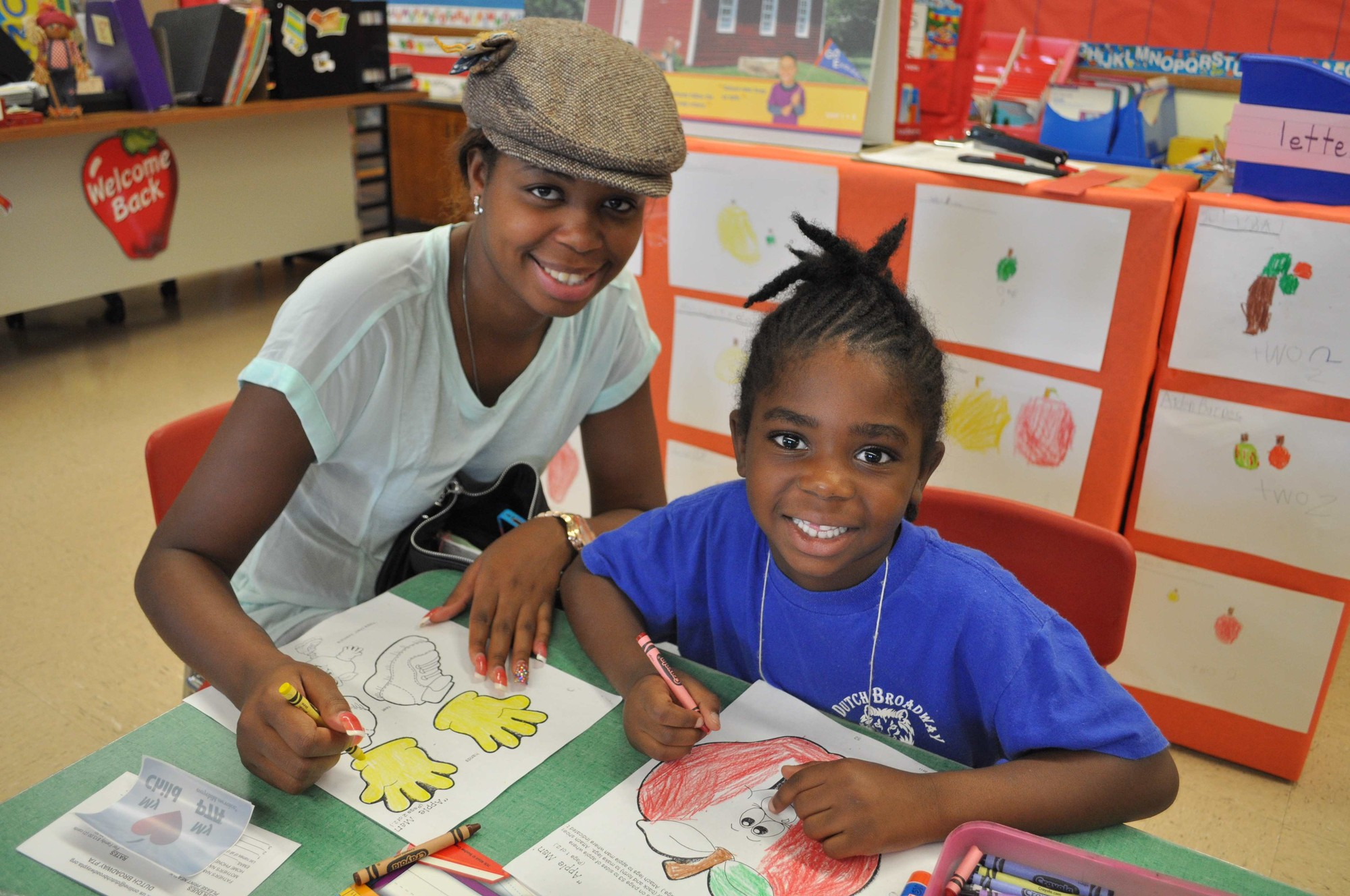 Kimona Cross assisted her daughter, Janiya McRae, during the annual Kindergarten Tea at Dutch Broadway School.