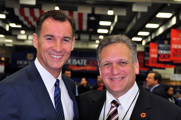 Tom Suozzi, left, and Ed Mangano, now battling for who will be the next county executive, were all smiles last Oct. 16 at the Presidential Debate at Hofstra University.