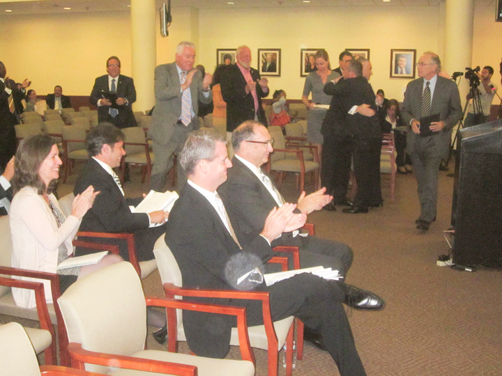 Forest City Ratner chairman Bruce Ratner, center, and his associates applauded moments after the Nassau County Legislature approved his proposal.