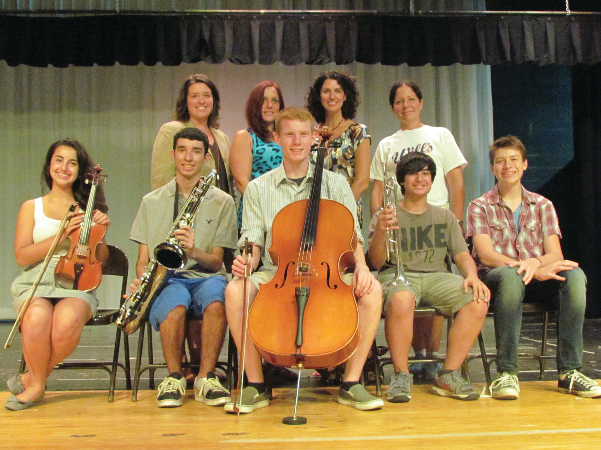 STAR MUSICIANS: Wantagh High School students, from left, Julianna Nerone, Mark Sales, Andrew Bloniarz, Matthew Saltzman and Patrick Constant have been selected as NYSSMA All-State musicians and are pictured with (back, from left) chorus teacher Jennifer Alessi, orchestra teacher Dina Langer, Supervisor of Music and Art Kelly Good and band teacher Mindy Dragovich.
