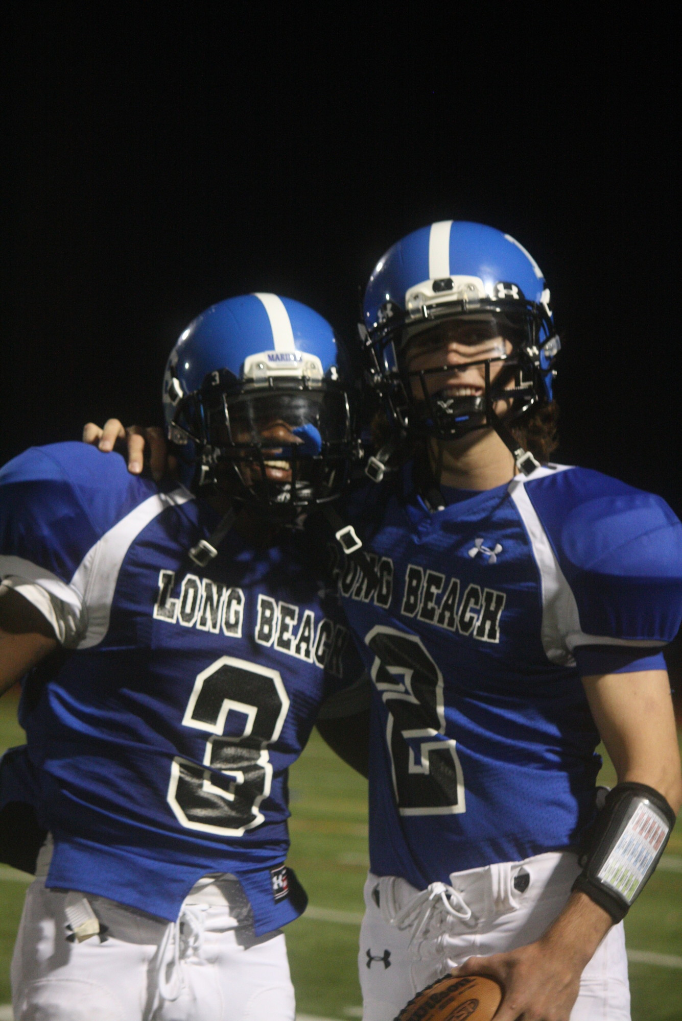 Running back Chris Parler, left, and quarterback Liam Rafferty helped the Marines rack up an impressive win against Herricks at the Long Beach High School Homecoming game.