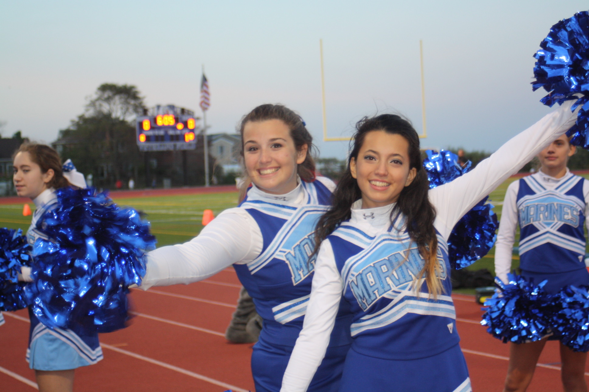 At the homecoming game, varsity cheerleaders Laura Capozzi, left, and Kristel Garces had plenty to cheer about, as the Marines earned their second win of the season.