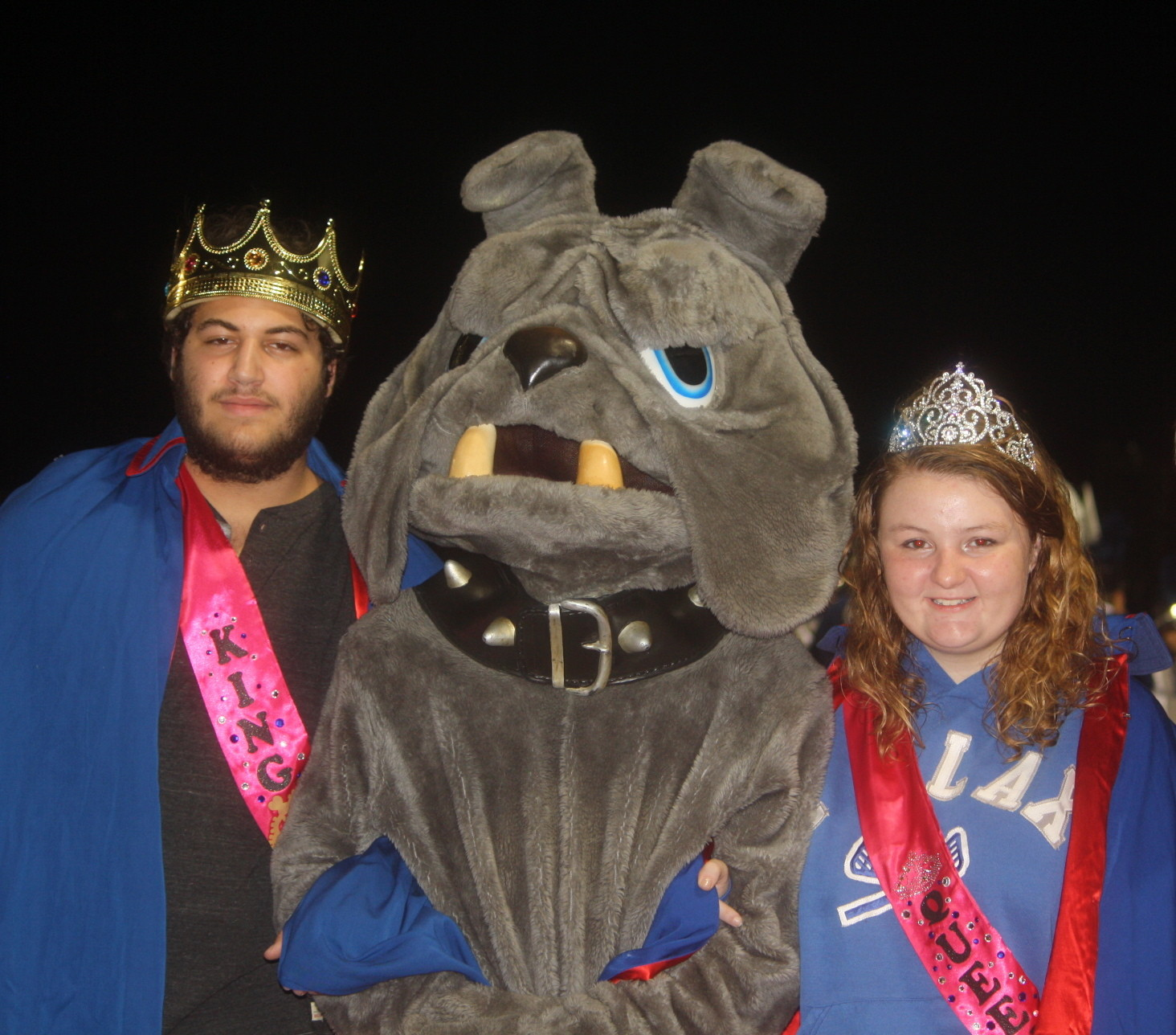 During the halftime festivities, homecoming king Sam Rabiner and queen Hannah Piazza were escorted onto the field by the Marines mascot.