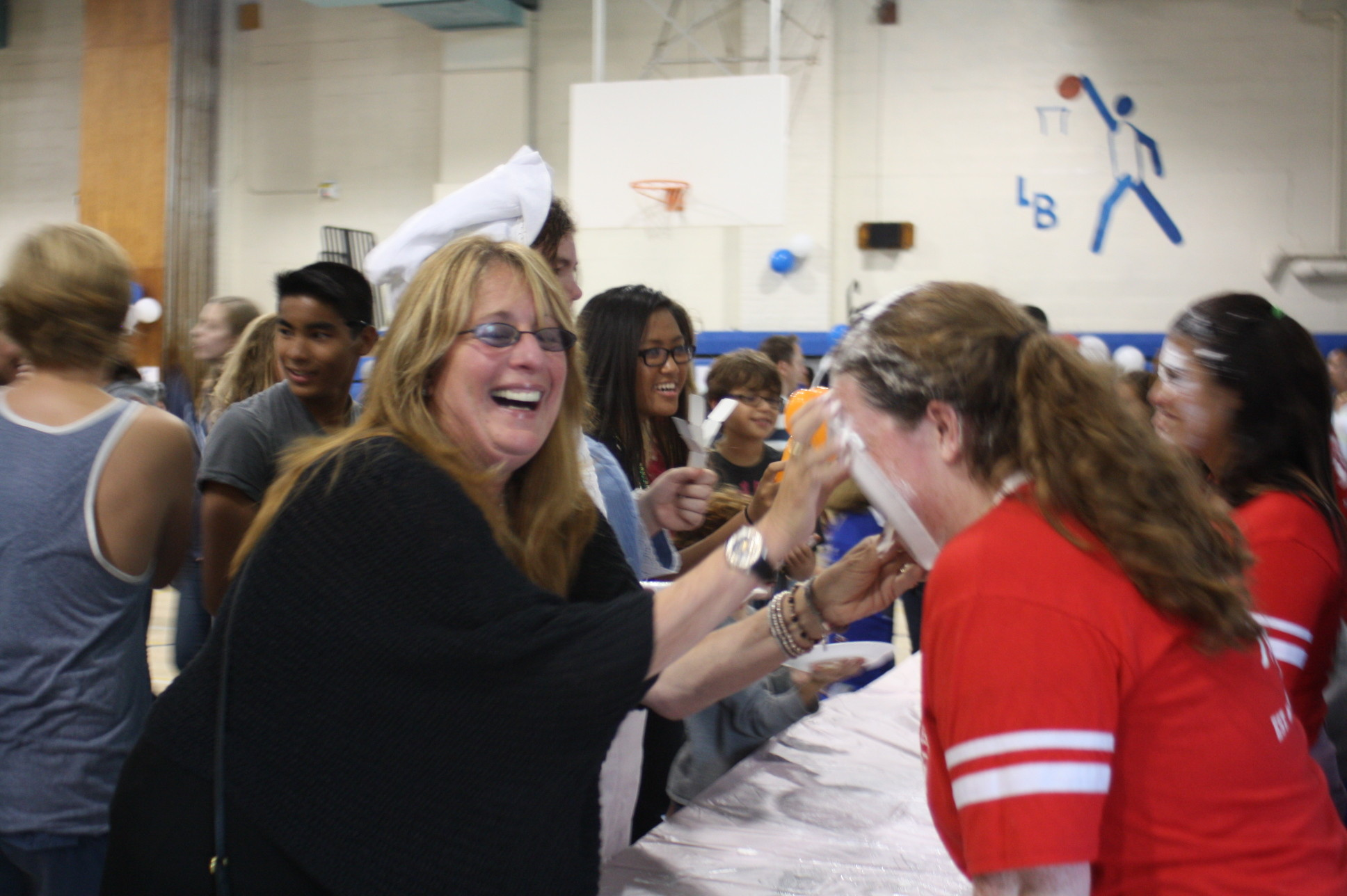 At the homecoming carnival, Debbie Goldman enjoyed smashing a pie in her daughter Allyson