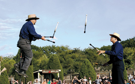 Jugglers amuse visitors to the Long Island Fair at Old Bethpage Village Restoration.