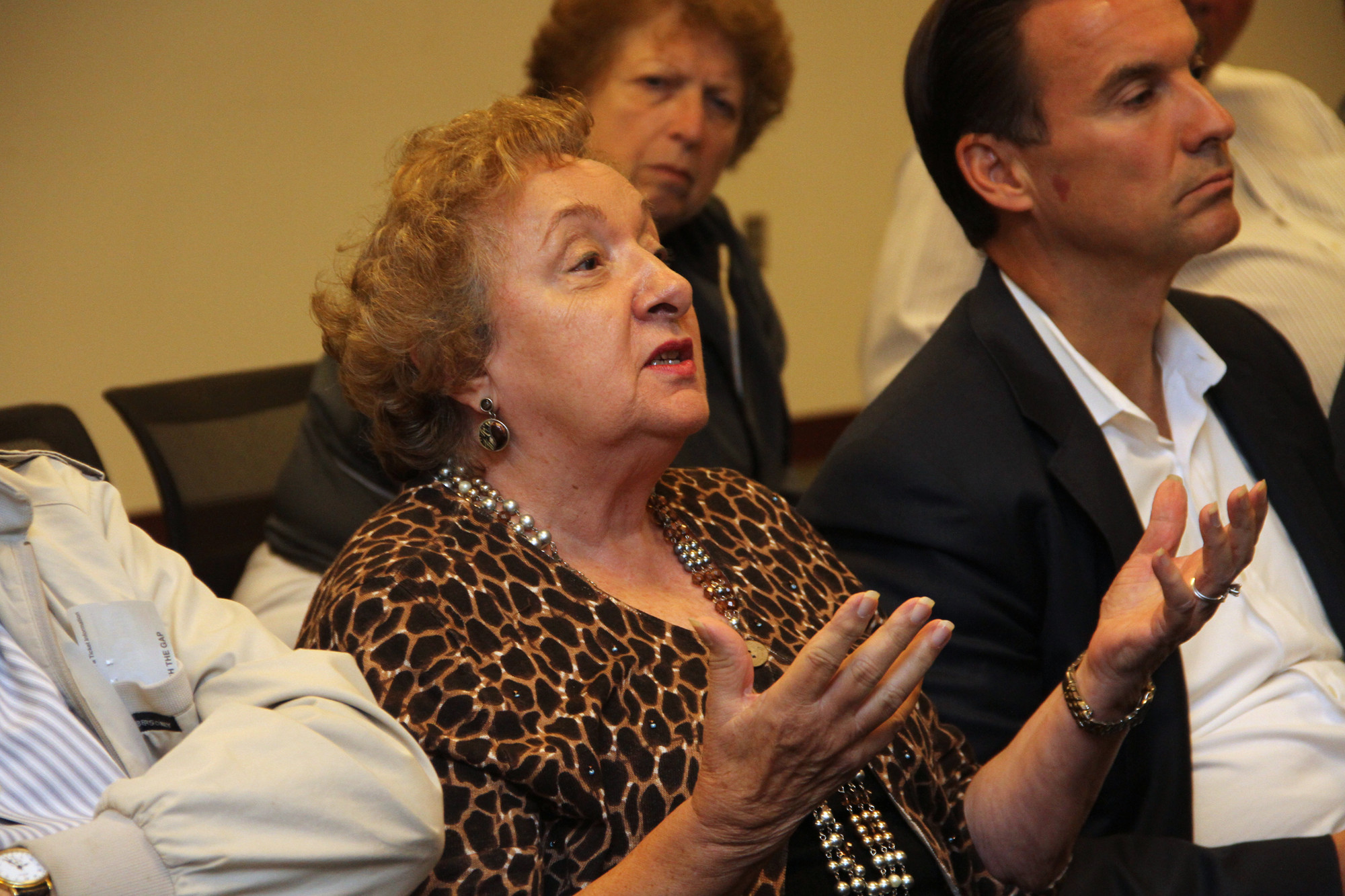 Rosalie Norton discussed taxes with former County Comptroller Howard Weitzman while former County Executive Tom Suozzi listened.