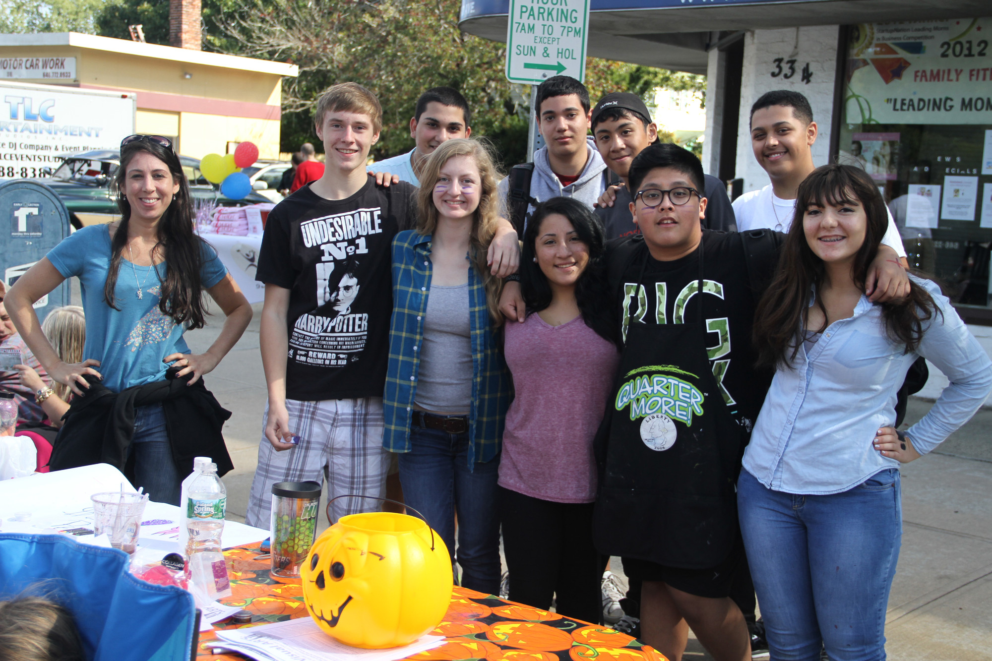 WHHS Art teacher and advisor Cassie Ross with members of the National Art Honor Society took their talents to the street during the Chamber of Commerce Street Fair.