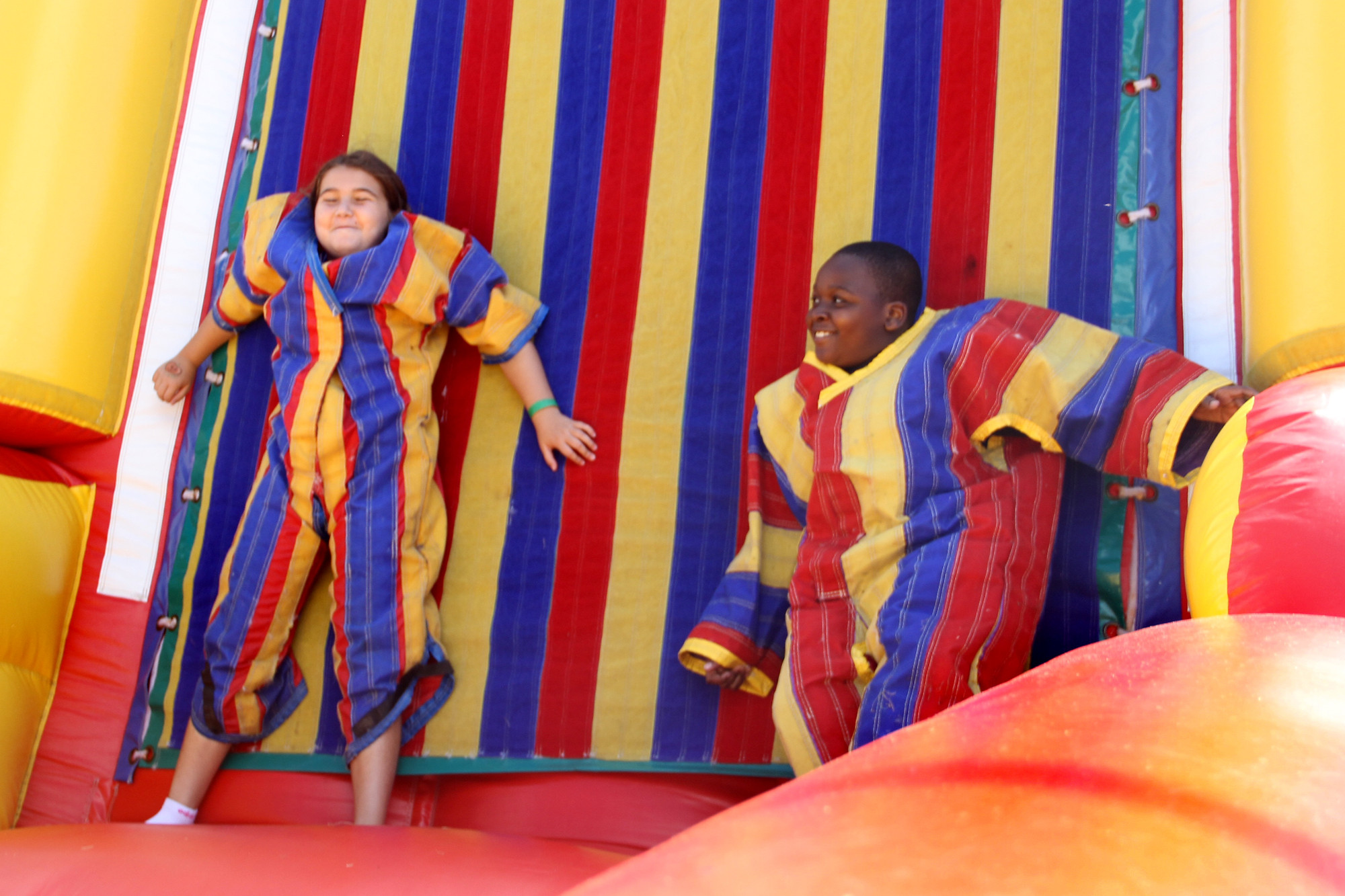 Dena Pezakas and Tory Marshall got caught up playing on the velcro wall.