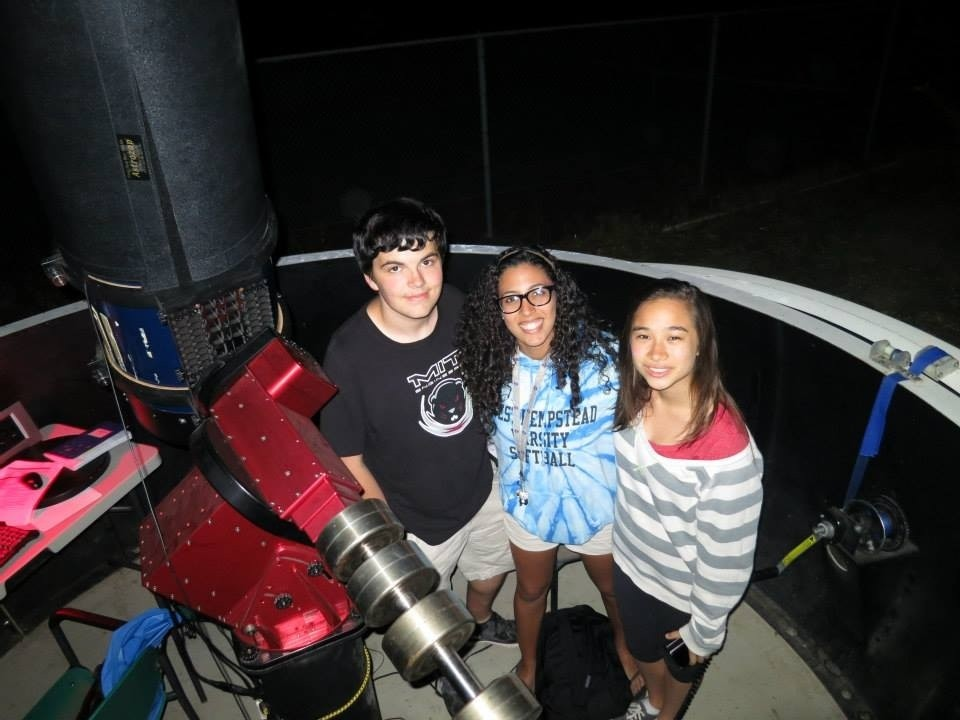 West Hempstead student Jamie Rodriguez, center, tracked an asteroid with a Meade 14