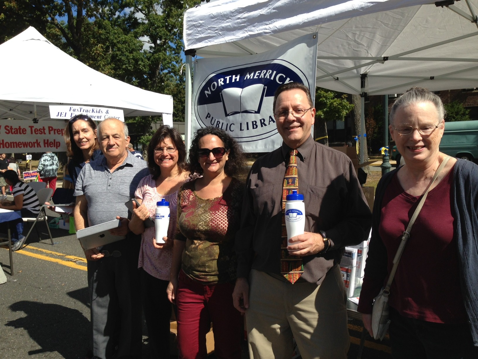 The staff of the North Merrick Public Library was on hand at the fair, including Director Tom Witt, second from right.