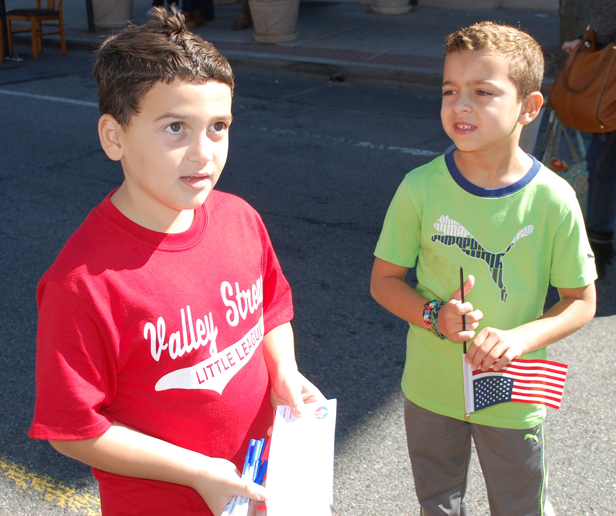 Nicholas Baez, 8, left, and Daniel Banach, 6, were signing fairgoers up for a free raffle for a chance to win a jersey from the Valley Stream Little League.