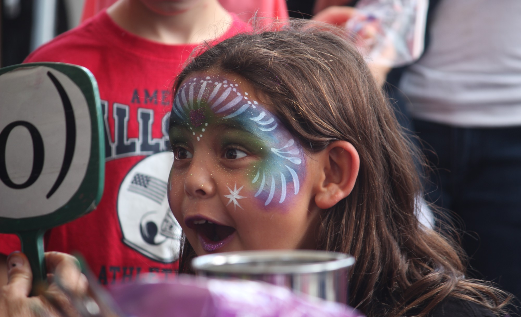 After having her face painted at the festival, Mara Riegel, 7, reveled in her new look.