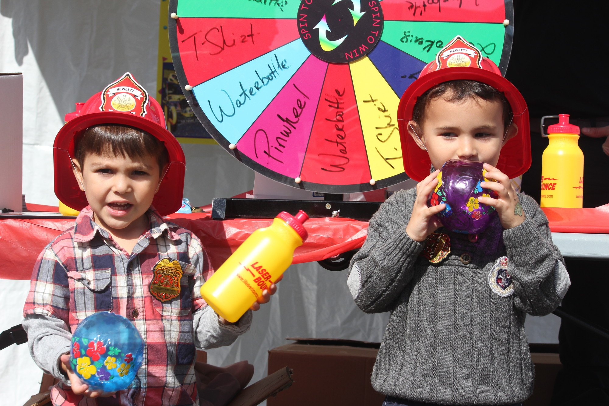 Hewlett Fire Department could have two new members in the future as Aleksander Koroveshi, left,  and Ben Lamdan, both 3, showed off their festival swag.
