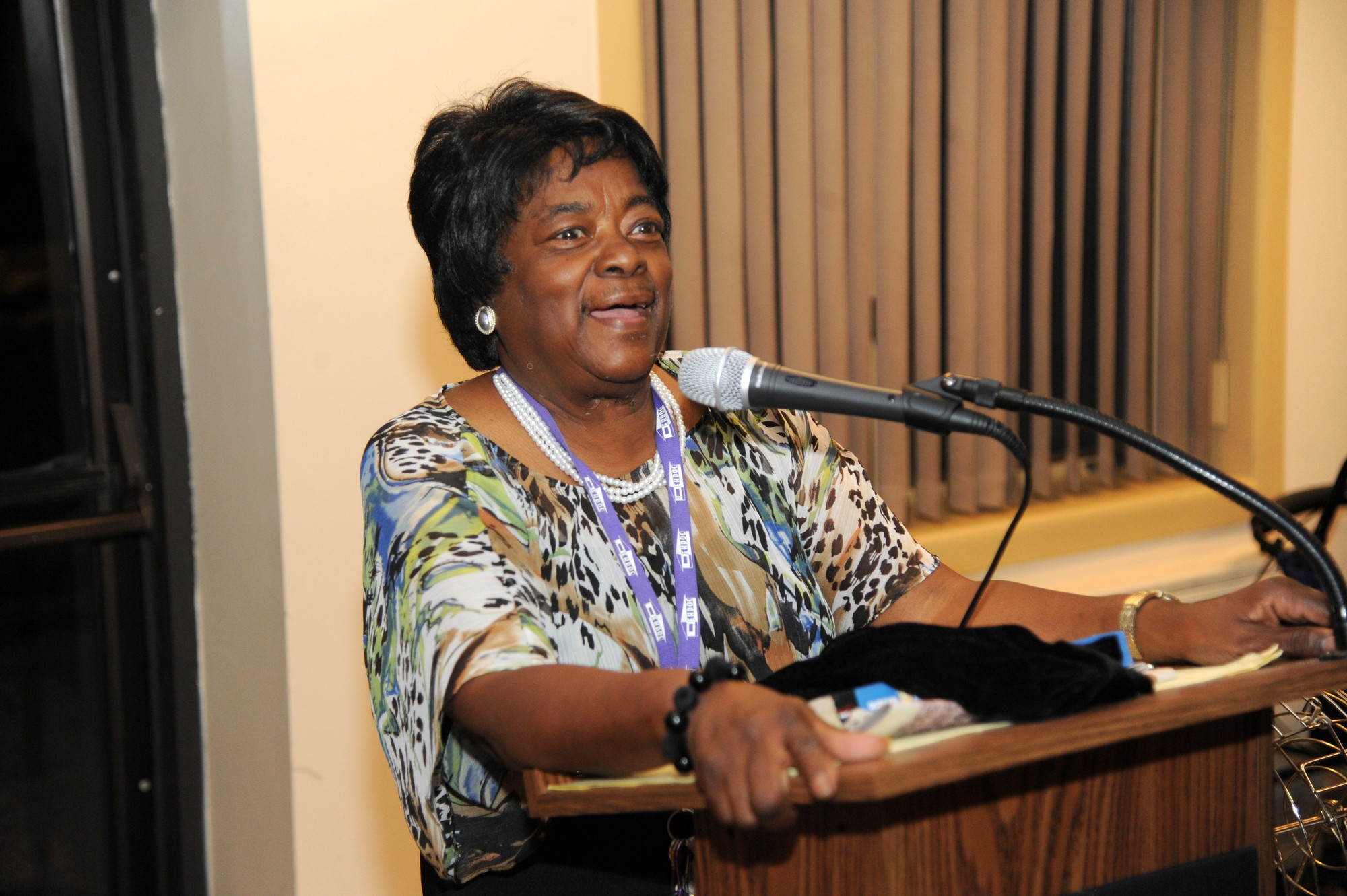 Director Juanita Warren, who is retiring after more than 20 years of service, addresses her family, staff and senior citizens at St. Mary