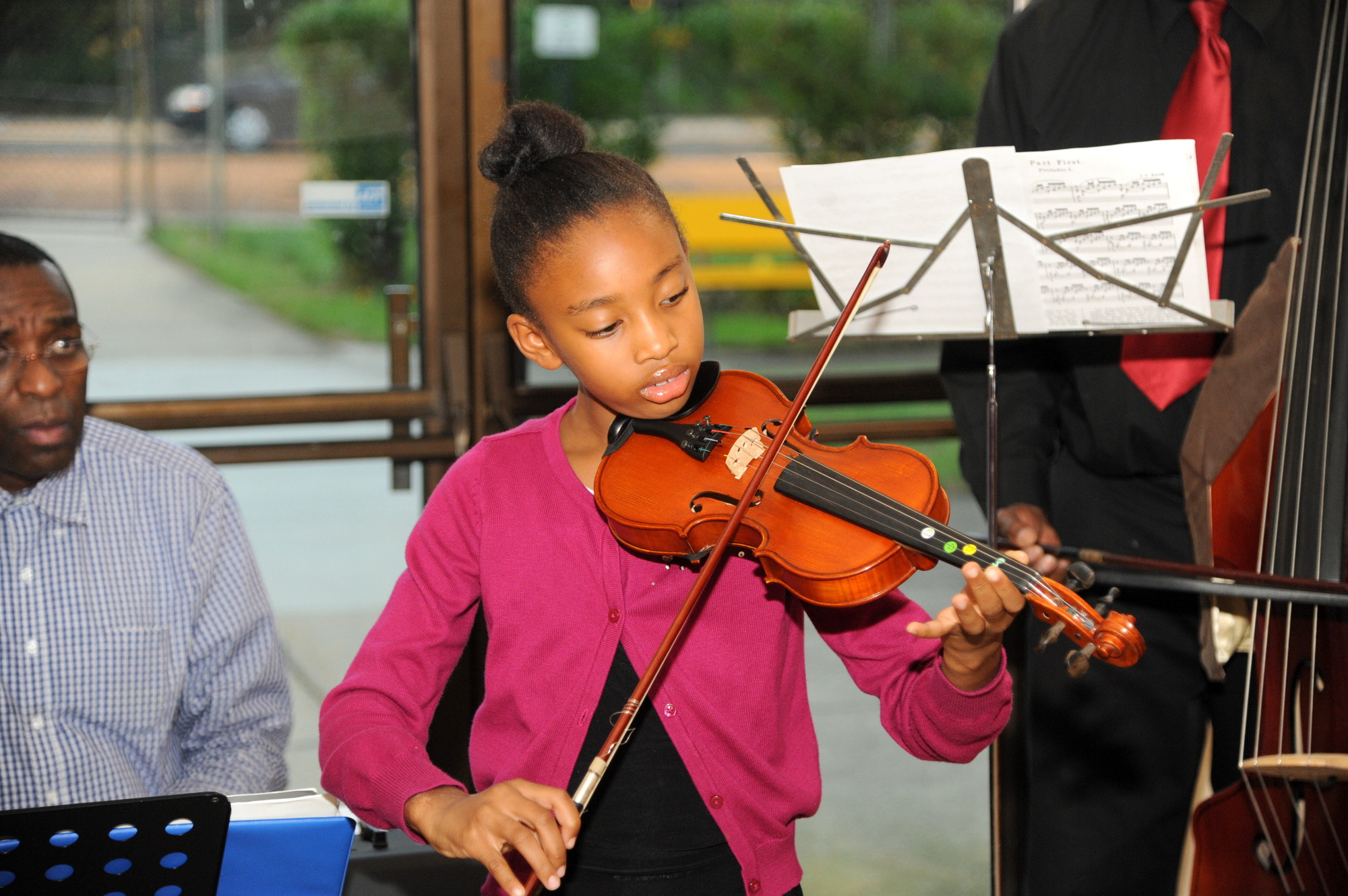 Brielle Mya Banks, 9, of the KeyNote Music Center, played the violin for the crowd at Juanita Warren