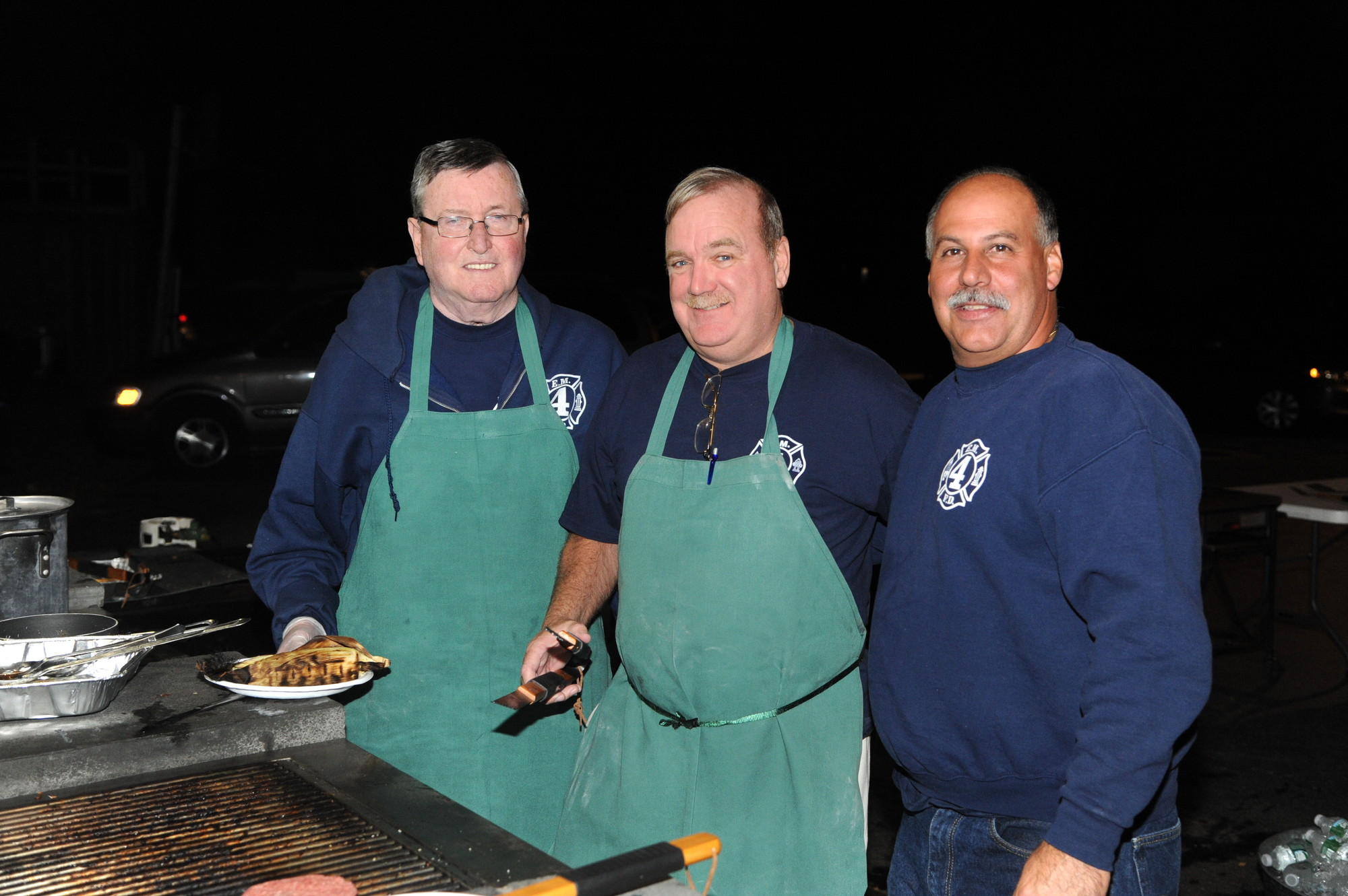 Station 4 volunteers Tom Callahan, at left, Dan Ward and Anthony Messina were chefs for the night.