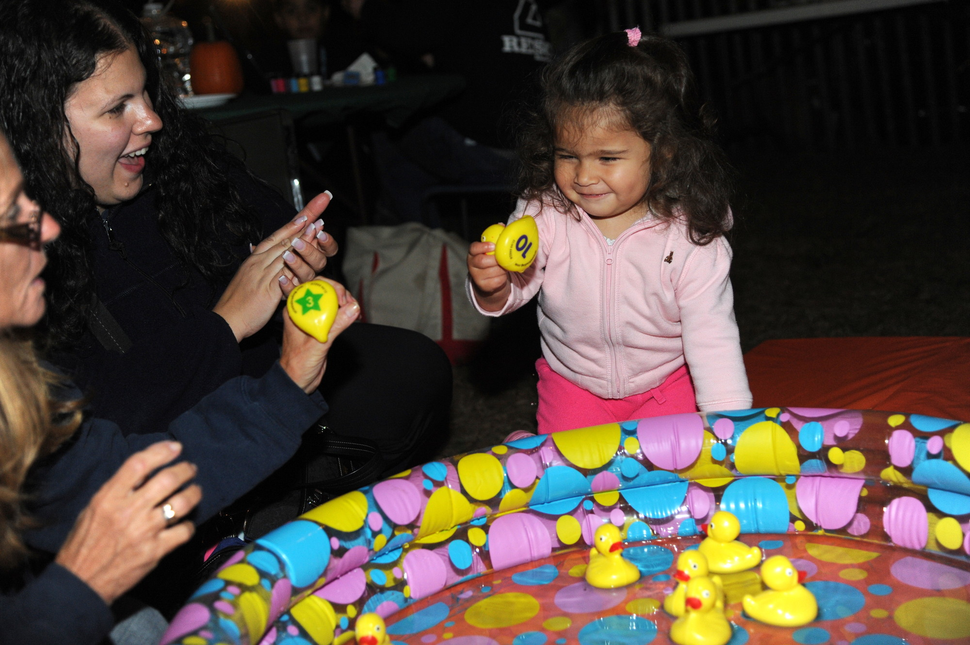 Jeanamarie Otero, 20 months old, pulled a rubber duck from the inflatable pool.