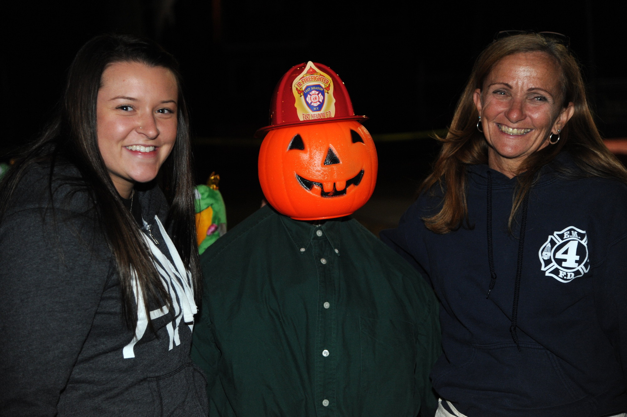 East Meadow Fire Department volunteers Amanda Bautista and Diane Tronolone posed with a pumpkin-headed scarecrow during the Station 4 festival in Salisbury last weekend.
