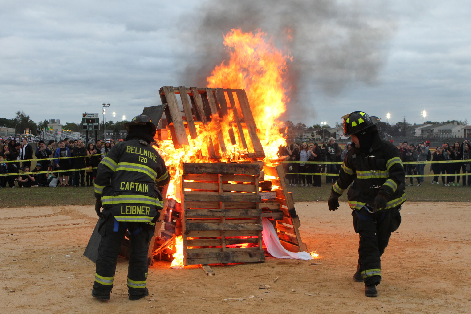 Bellmore Fire Department officials lit the traditional bonfire while the