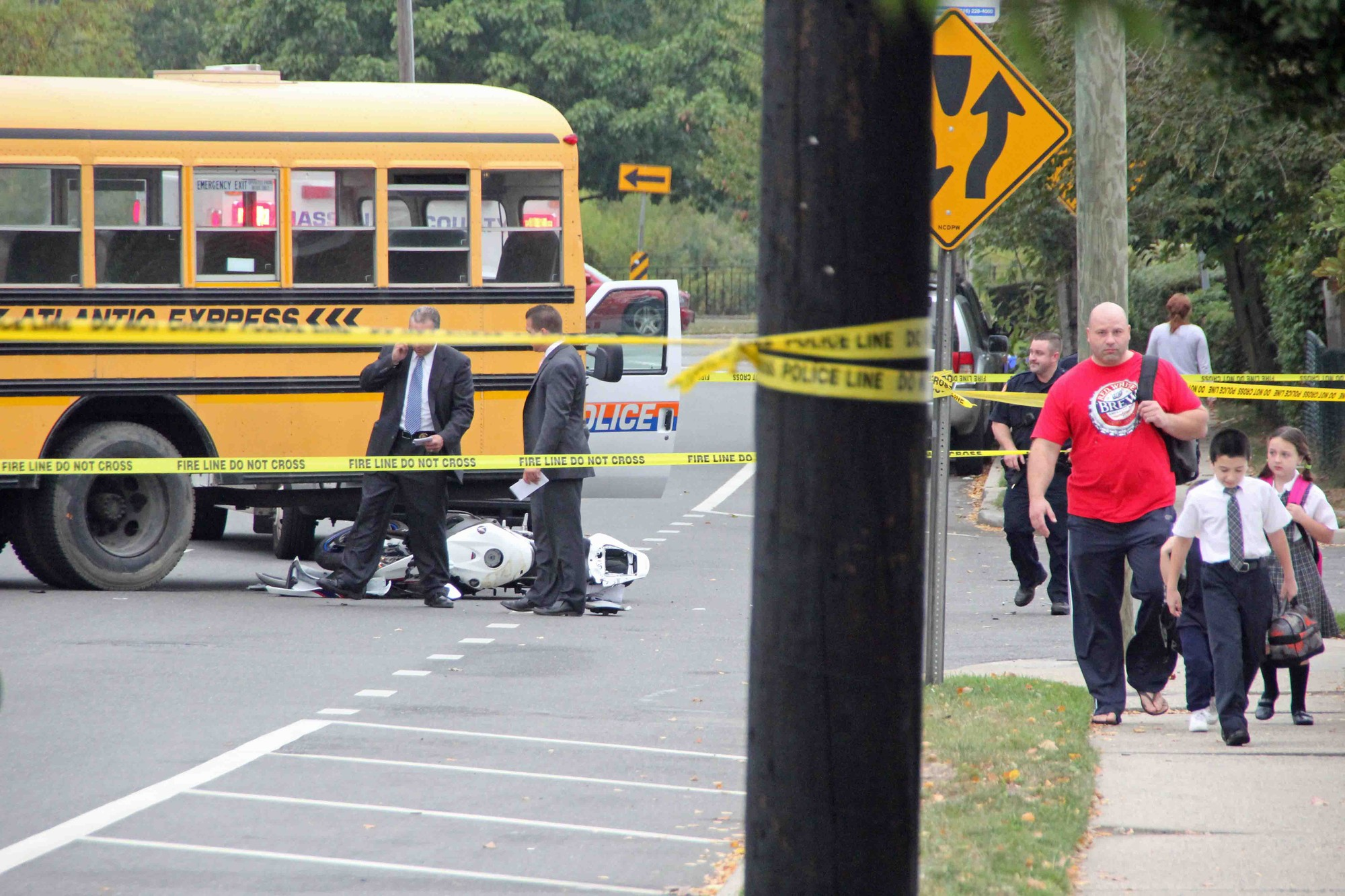 A motorcycle rider crashed into a school bus near the corner of Merrick Rd. and Lancaster Avenue this morning.