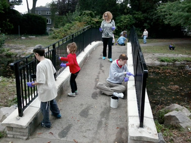 West Hempstead residents paint some railings at Hall