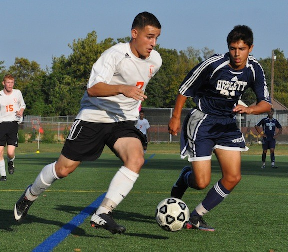 Carey's Gino Scardino, left, moved past Hewlett's Gianni Preziosi on the way to scoring in the first half of the Seahawks' 2-1 win on Oct. 2.