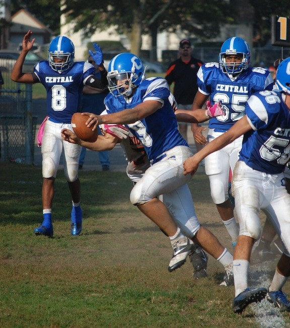 Central quarterback Vito Friscia scores one of his two running touchdowns in the Eagles 49-6 victory over the Hicksville Comets last Saturday at Firemen