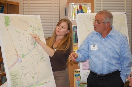 Jennifer Gonzalez and Marc Tenzer reviewed maps of Mill Brook during the Sept. 26 CRZ planning committee meeting.