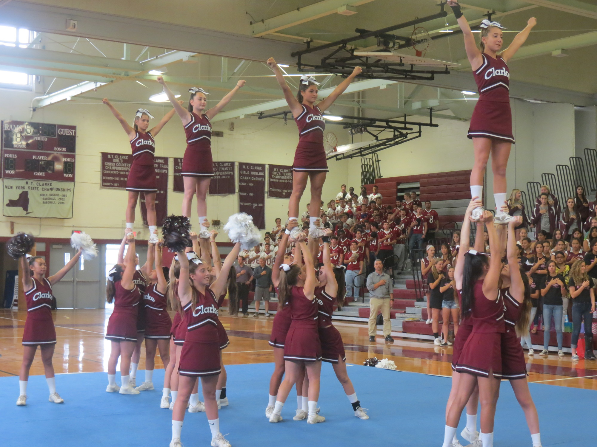 Cheerleaders energized the crowd in the school gymnasium.