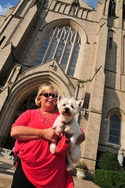 Kathy Horace and her West Highland Terrier Madeline waited to be blessed.