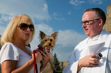 Kathy Martinez and her dog King with Fr. McHugh outside of St. Agnes.
