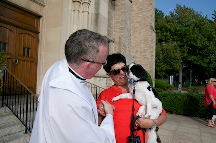 Father McHugh blessed Lorie Fusco and Oliver, the Japanese chin