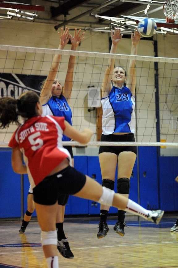 Long Beach's Perri Steiner, right, soars over the net for a block during the team's victory at South Side on Oct. 2.