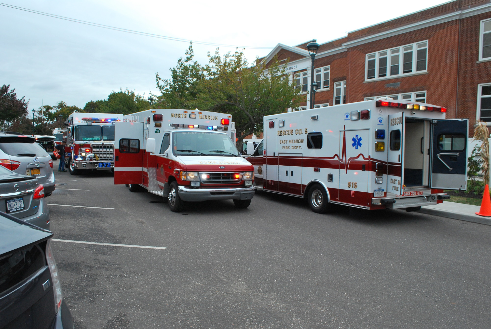 "Ambulances sat Thursday afternoon outside Camp Avenue School in North Merrick. A boiler in the school leaked ""black smoke,"" according to the North Merrick School District. School officials called 911 ""as a precaution,"" said North Merrick Superintendent David Feller."