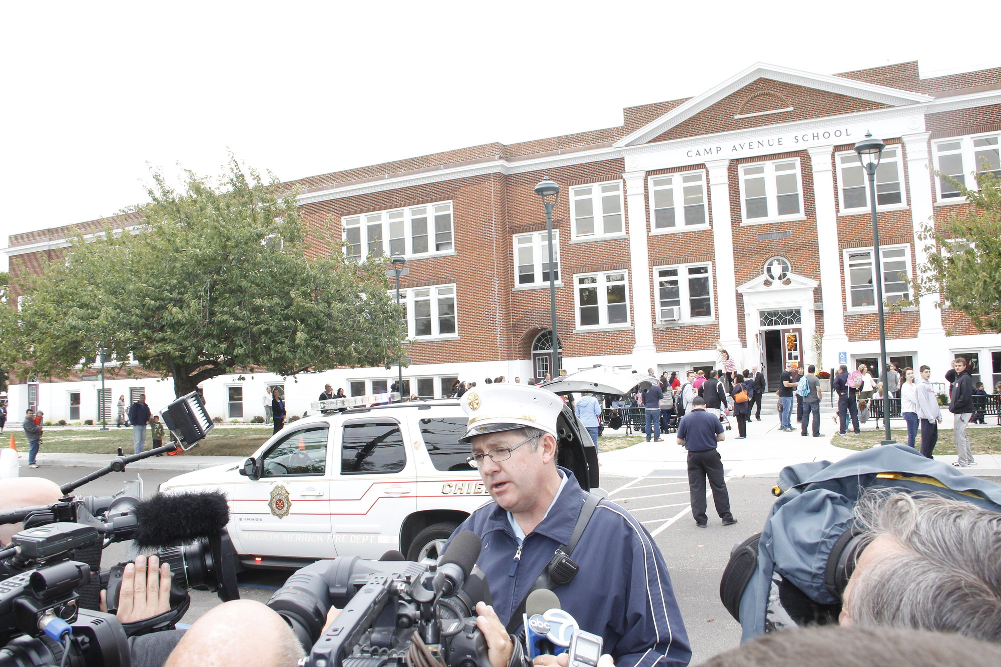 James Rogers, first assistant chief of the North Merrick Fire Department, addressed reporters Thursday outside Camp Avenue School.