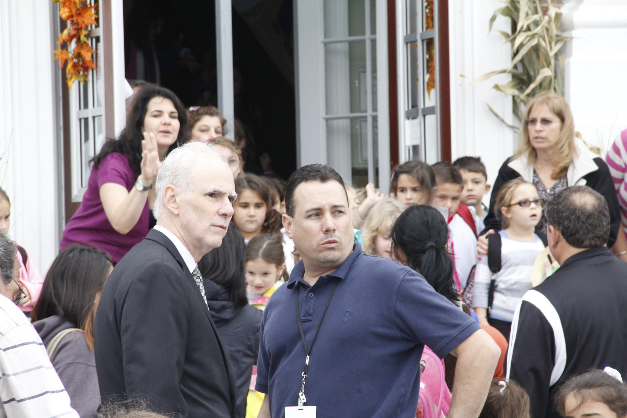 David Feller, superintendent of the North Merrick School District, left, and James Saitta, the district's facilities director, right, were on hand Thursday afternoon at Camp Avenue School talking to parents, students, and emergency responders.