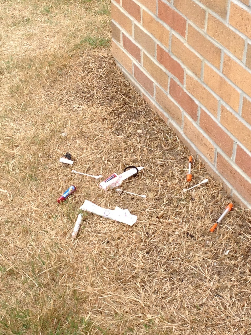 The South Merrick Community Civic Association provided the Herald Life with this photograph, which appears to show needles on the ground outside Levy-Lakeside School along with other items, including a tampon and cotton swabs, which drug users sometimes use to inject intravenous drugs.