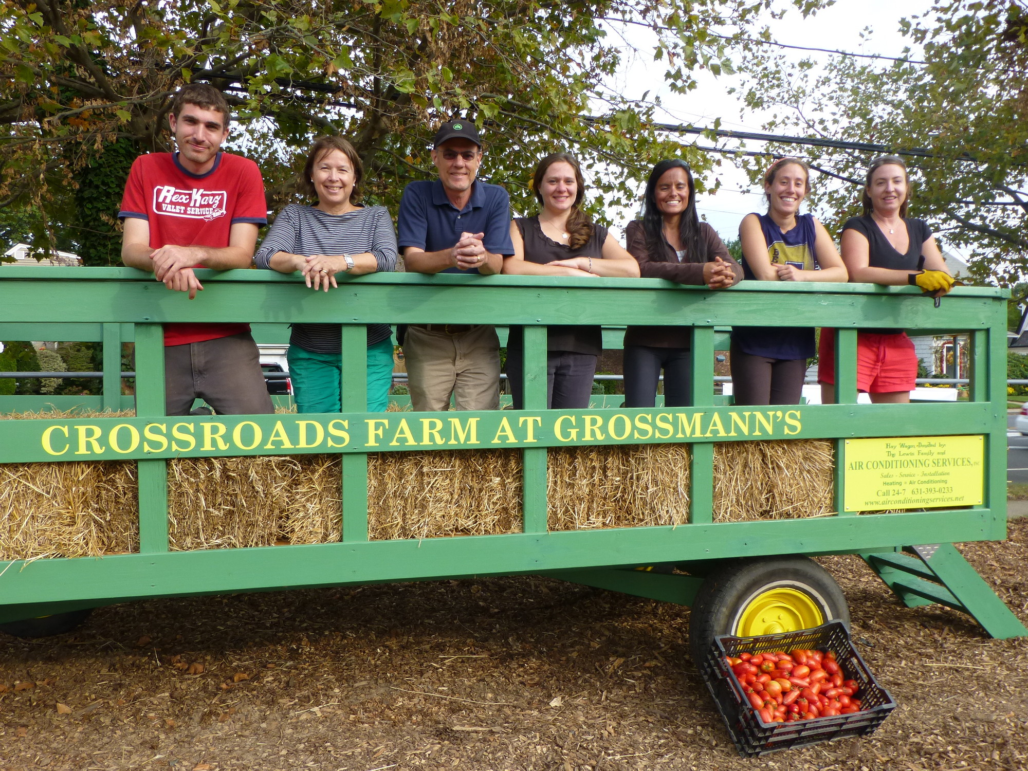 Crossroads staff, including Education Director Leonore Russell, second from left, Nassau Land Trust Treasurer Rick White, farm Director Elizabeth Schaefer, staff employee Stephanie, farm Director Meaghan Corcoran, far right, and volunteers in their brand new hayride.