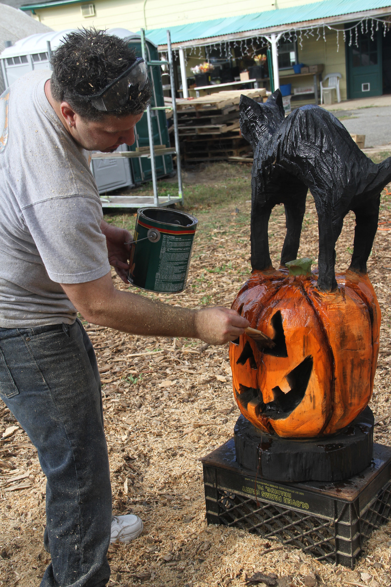 Artist Craig Mastandrea of Wood Cut Designs put the finishing touches on his spooky wood sculpture at the event.