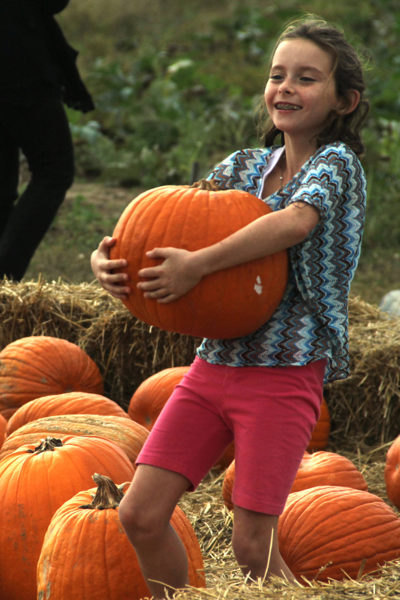 Emily Bradley scored a huge pumpkin from the Crossroads patch.