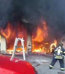 Members of the Elmont Fire Department fought a rapidly spreading fire at a Linden Boulevard commercial garage.