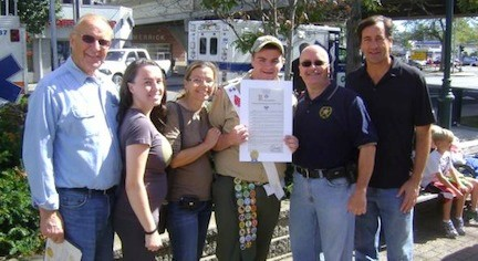 State Assemblyman David McDonough, far left, and Sen. Charles Fuschillo Jr., far right, honored Eagen with a special citation at the recent Merrick Fall Festival.
