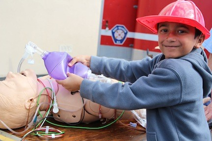 Aspiring doctor Antonio Rivera, 7, above, practiced his life-saving skills.