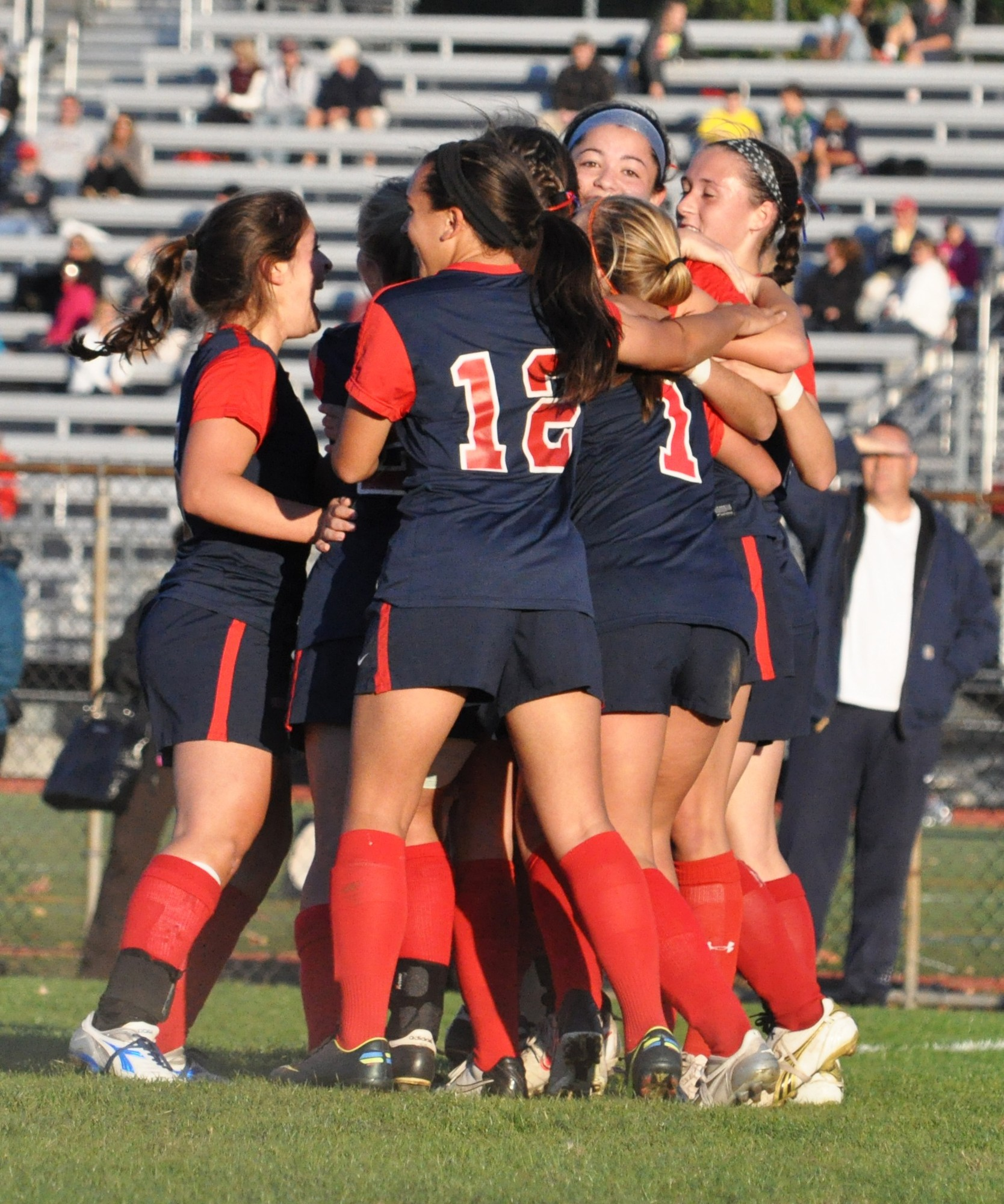 The Lady Cyclones celebrated after Juliana Pellegrini's first-half goal in Monday's 2-1 win at Garden City that clinched the conference title.