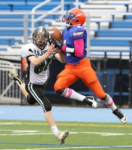 Malverne's Danny Williams, right, hauled down a 57-yard touchdown pass from Jamal Hill in the second quarter of last Saturday's win.