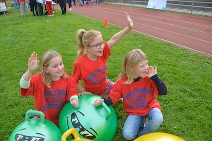 Katherine Ahern, left, Kyla Murphy and Morgan Harloff, all 7, cheered on the walkers from the sidelines.