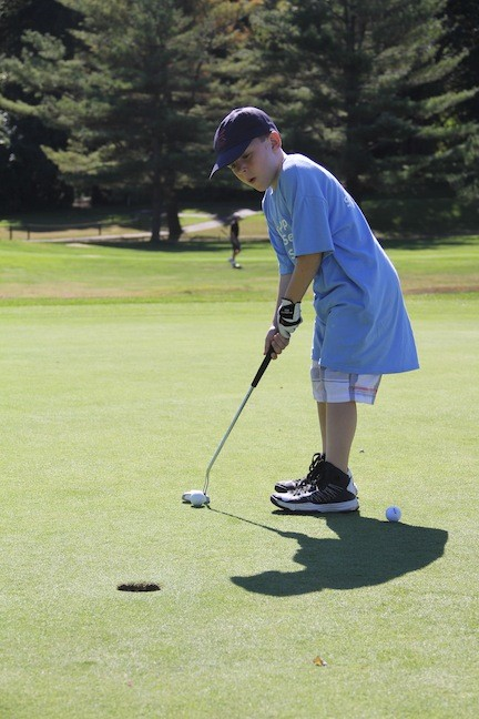 Sean Hatzfeld putted at the Tee Up to Drive Out Sepsis golf outing at Glen Cove Golf Club on Sept. 30, which raised $25,000 for sepsis education and treatment at Winthrop-University Hospital.