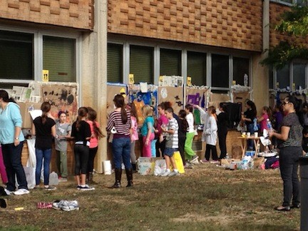 Students painted windows at the Oceanside High School on Oct. 11.