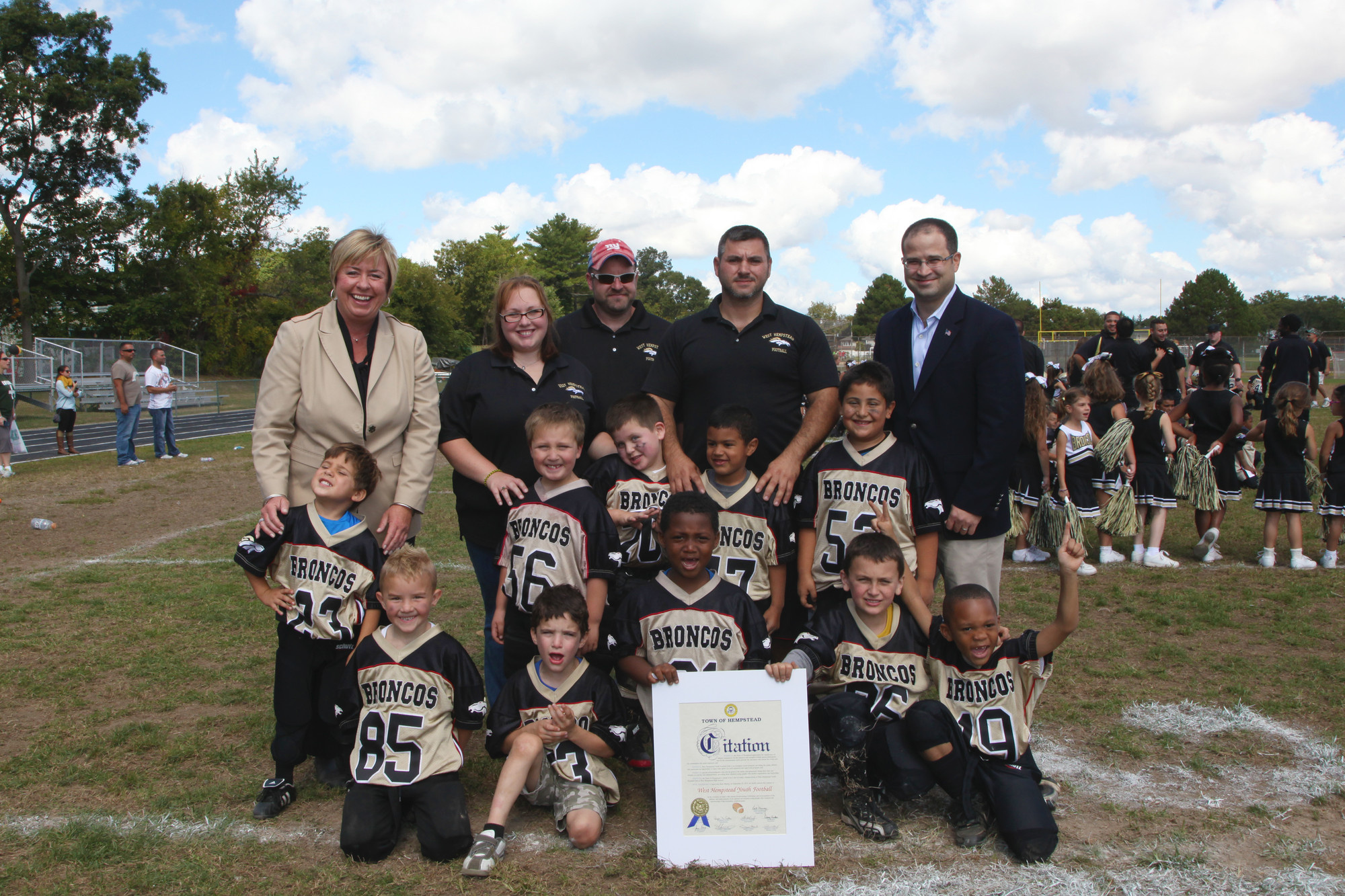 West Hempstead Broncos Peanuts players greeted Town Supervisor Kate Murray, left, New York State Assemblyman Ed Ra, far right, Head Coach Tony and Coaches Rich and Victoria Sharvin of West Hempstead at the 2013 West Hempstead Youth Football Club Opening Day Ceremony.