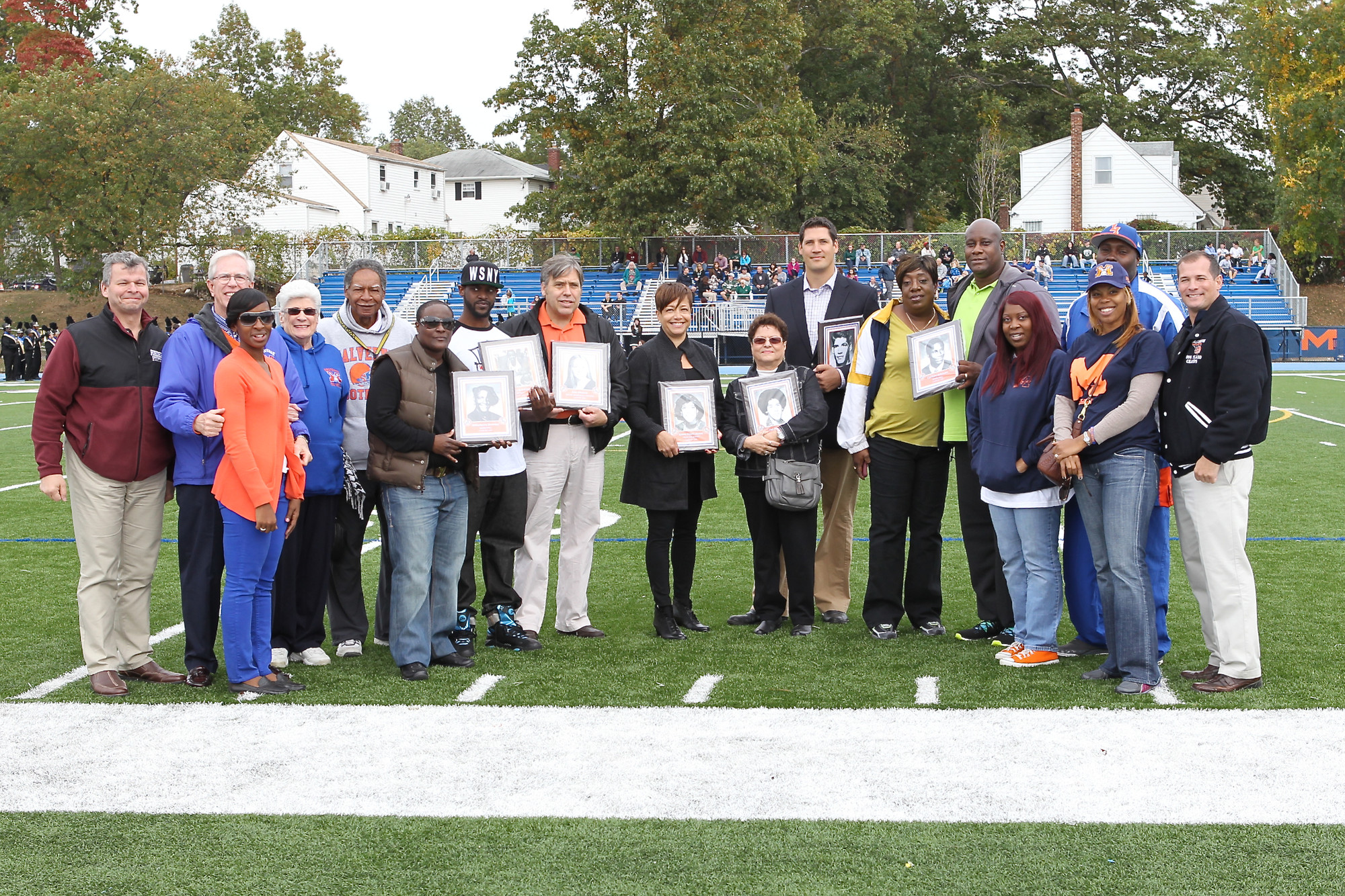 Malverne Hall of Fame  inductees reminisced about their glory days with Malverne High Principal Dr. Vincent Romano, far right, and members of the Board of Education.